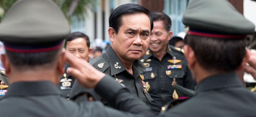 Thailand's new Prime Minister Prayuth Chan-ocha, center, arrives for an establishment anniversary of the 21st infantry regiment, Queen's Guard in Chonburi Province, Thailand, Aug. 21, 2014.