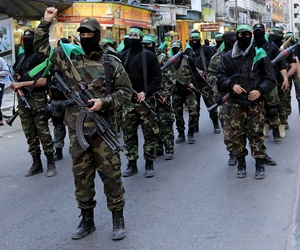 Palestinian masked militants of Izzedine al-Qassam Brigades, a military wing of Hamas, take part in a parade in Gaza on March 23, 2015.