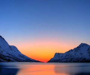 A photo of a sunset in Norway, near the town of Tromse, where the submarine base is located.