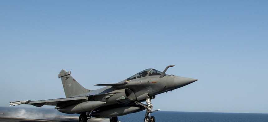 A French navy Rafale Marine aircraft launches from the U.S. Navy aircraft carrier USS Carl Vinson, on March 3, 2015.