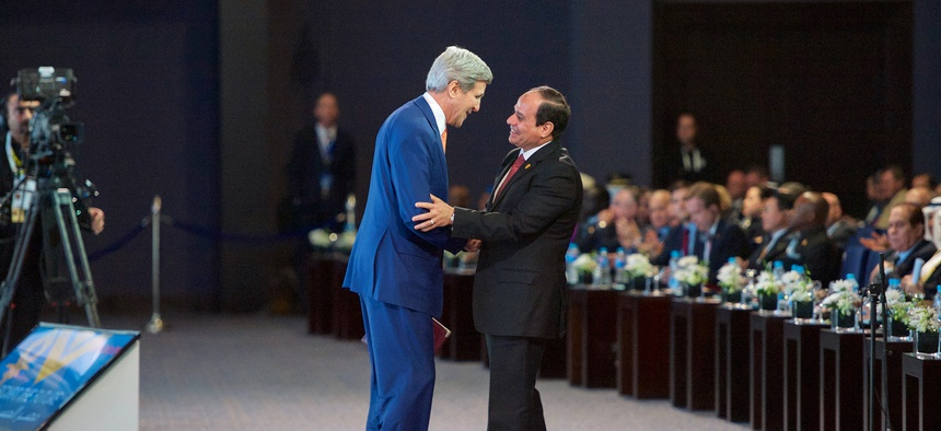 Egyptian president al-Sisi thanks Secretary of State John Kerry after an address at Sharm el-Sheik, on March 13, 2015.