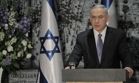 Israeli Prime Minister Benjamin Netanyahu speaks during a ceremony with Israeli President Reuven Rivlin, not seen, in Jerusalem, Wednesday, March 25, 2015.