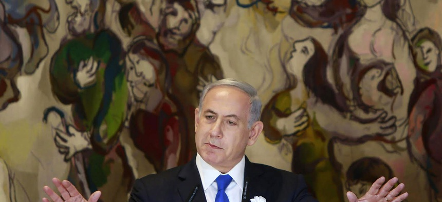 Israel's Prime Minister Benjamin Netanyahu delivers a speech during an event following the first session of the newly-elected Knesset in Jerusalem, March 31, 2015.