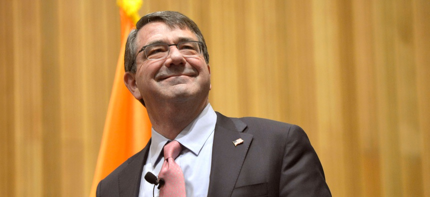 Defense Secretary Ash Carter greets the audience before participating in a roundtable discussion with members of the Institute for Veterans and Military Families at Syracuse University in Syracuse, N.Y., March 31, 2015.