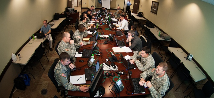 Army Reserve computer tech support experts answer calls during the Enterprise Email Migration at the U.S. Army Forces Command and U.S Army Reserve Command headquarters, Jan. 14, 2013.