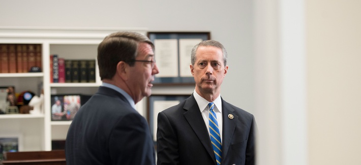 Defense Secretary Ashton Carter talks with House Armed Services Committee Chairman Rep. Mac Thornberry (R-TX) before testifying before the House Armed Services Committee in Washington. March. 18, 2015.