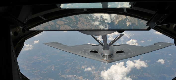 A KC-135 Stratotanker from the 22nd Air Refueling Wing refuels a B-2 Spirit from the 509th Bomb Wing, July 12, 2012.
