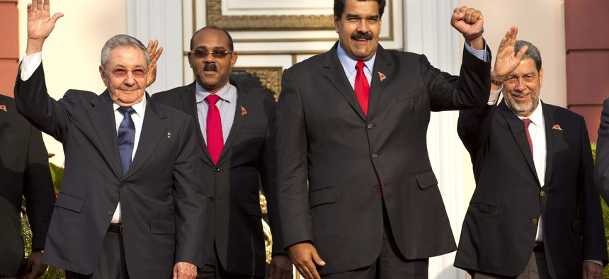 Cuba's President Raul Castro, Prime Minister of Antigua and Barbuda Gaston Browne, Venezuela's President Nicolas Maduro, and Saint Vincent and the Grenadines Prime Minister Ralph Gonsalves pose for a group photo on March 17, 2015.