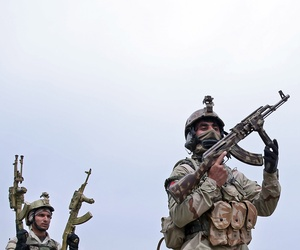Afghanistan's interior ministry special forces take position during a military exercise in Kabul, Afghanistan, Thursday, April 2, 2015.