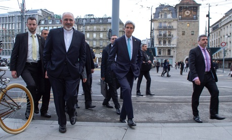 U.S. Secretary of State John Kerry and Iranian Foreign Minister Javad Zarif cross a street while taking a walk in Geneva, Switzerland, on January 14, 2015.