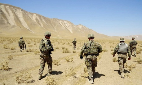 U.S. Soldiers assigned to Bravo Troop, 6th Squadron, 4th Cavalry Regiment, 3rd Brigade Combat Team, 1st Infantry Division, based out of Fort Knox, Ky., patrol the area outside of the proposed range in Kunduz, Afghanistan, July 3, 2013.