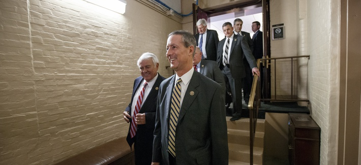 Rep. Mac Thornberry, R-Texas, center, and other House Republicans emerge from a closed-door meeting in the basement of the Capitol on how to deal with the impasse over the Homeland Security budget, in Washington, Thursday night, Feb. 26, 2015.