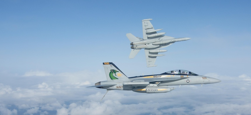 Two F/A-18G Growlers of the U.S. Navy's Electronic Attack Squadron 130