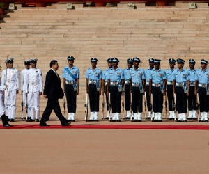 Chinese President Xi Jinping inspects a guard of honor during a ceremonial reception in New Delhi, India, Sept. 18, 2014.