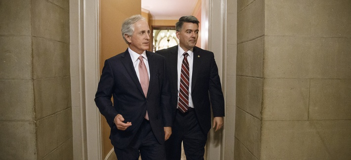 Senate Foreign Relations Committee Chairman Bob Corker, R-Tenn., left, and Sen. Cory Gardner, R-Colo., walk through a corridor at the Capitol after a closed-door meeting on Capitol Hill.