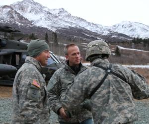 Under Secretary of the Army Brad Carson, along with Maj. Gen. Michael H. Shields, commanding general of U.S Army Alaska, arrive at Black Rapids Training Site, Nov. 18, 2014.