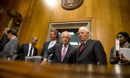 Senate Foreign Relations Committee Chairman Sen. Bob Corker, R-Tenn., center, speaks with the committee's ranking member Sen. Ben Cardin, D-Md., on Capitol Hill in Washington, Tuesday, April 14, 2015.