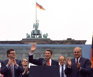 In this June 12, 1987 file picture, U.S. President Ronald Reagan acknowledges the applause after speaking to an audience in front of the Brandenburg Gate in Berlin.