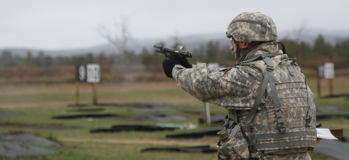 A specialist with the 533rd Brigade Support Battalion competes in a 9mm pistol course at the Best Warrior Competition at Fort McCoy, Wisc., on April 29, 2014.
