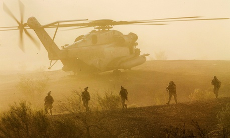 Marines with 1st Battalion, 5th Marine Regiment, participate in a heavy helo raid during Weapons and Tactics Instructor Course 2-15 at K-9 Village, Yuma Proving Grounds, Arizona, April 8, 2015.