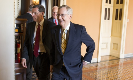 Senate Majority Leader Mitch McConnell, R- Ky., right, walks with Sen. John Barrasso, R-Wyo., left, and Senate Majority Whip John Cornyn of Texas, center, to a news conference on Capitol Hill in Washington, Tuesday, April 21, 2015.