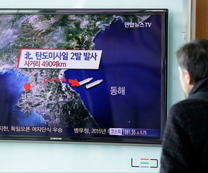 A man watches a TV news program reporting that North Korea fired two short-range ballistic missiles, at Seoul Railway Station in Seoul, South Korea, Monday, March 2, 2015.