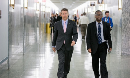 Republican Presidential candidate Sen. Rand Paul, R-Ky., center, walks on Capitol Hill in Washington, Wednesday, April 15, 2015.