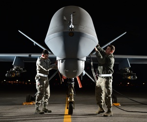 Airman 1st Class Steven (left) and Airman 1st Class Taylor prepare an MQ-9 Reaper for flight during exercise Combat Hammer, May 15, 2014, at Creech Air Force Base, Nev.