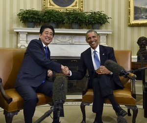 President Barack Obama shakes hands with Japanese Prime Minister Shinzo Abe during their meeting in the Oval Office of the White House in Washington, Tuesday, April 28, 2015.