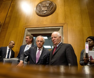 In tbis April 14, 2015 file photo, Senate Foreign Relations Committee Chairman Sen. Bob Corker, R-Tenn., center, speaks with the committee's ranking member Sen. Ben Cardin, D-Md., on Capitol Hill in Washington.
