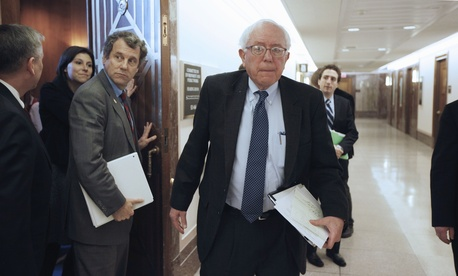 Sen. Bernard Sanders, I-Vt., right, and Sen. Sherrod Brown, D-Ohio, emerge from a closed meeting of the Social Security caucus, Thursday, Jan. 27, 2011.