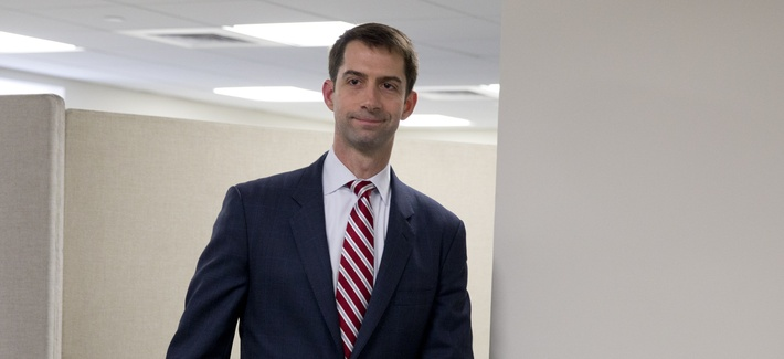 Sen. Tom Cotton, R-Ark. arrives to pose for photographers in his office on Capitol Hill in Washington, Wednesday, March 11, 2015.