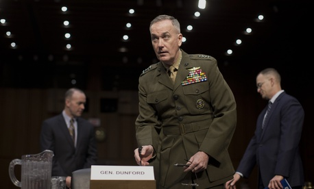 Marine Gen. Joseph F. Dunford, Jr., Commander, International Security Assistance Force, arrives on Capitol Hill in Washington, Wednesday, March 12, 2014, to testify before the Senate Armed Services Committee on the situation in Afghanistan.