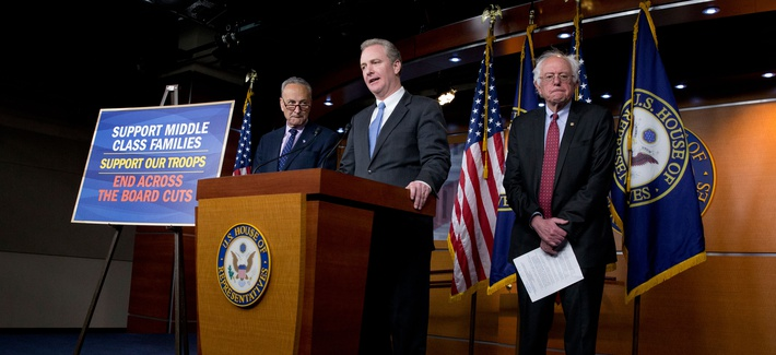 Rep. Chris Van Hollen, D-Md.,, center, flanked by Sen. Bernie Sanders, I-Vt., right, and Sen. Charles Schumer, D-N.Y., speaks during a news conference on Capitol Hill in Washington, Wednesday, April 29, 2015, to speak out against the Republican budget.