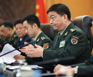 Chinese Minister of Defense Chang Wanquan gestures during a meeting with then-US Defense Secretary Hagel, April 8, 2014, at the Chinese Defense Ministry in Beijing, China.