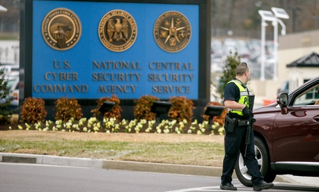 A police officer directs a vehicle to turn away at the National Security Agency, Monday, March 30, 2015, in Fort Meade, Md.
