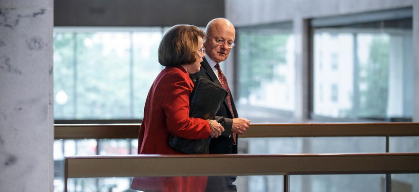 Sen. Dianne Feinstein, D-Calif., left, chair of the Senate Intelligence Committee, walks with National Intelligence Director James Clapper on Capitol Hill following a closed-door briefing, in Washington, Sept. 9, 2014
