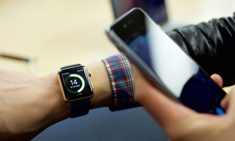 n excited customer tries on the Apple Watch Edition at the Eaton Centre Apple Store on Friday, April 10, 2015 in Toronto.~