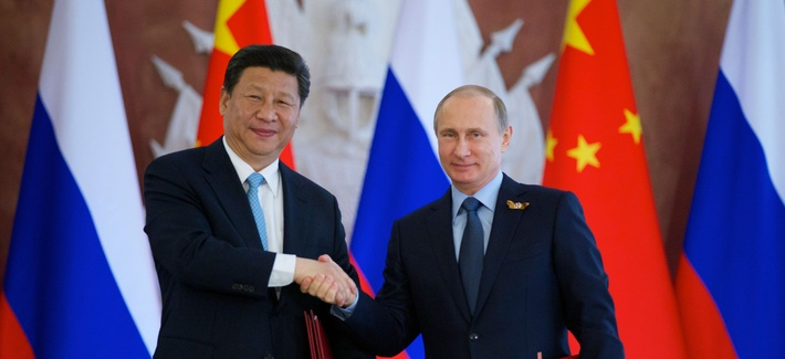 Russian President Vladimir Putin, right, and Chinese President Xi Jinping shake hands at the signing ceremony in the Kremlin in Moscow, Friday, May 8, 2015.