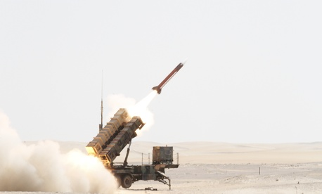 A Patriot missile is launched by Soldiers from C-Battery, 3rd Battalion (Airborne), 4th Air Defense Field Artillery Regiment, 108th Air Defense Artillery Brigade, at an airborne target during a joint live-fire exercise held Oct. 1, 2014.