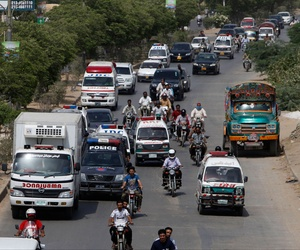 Ambulances take bodies of attack victims to a hospital for autopsies in Karachi, Pakistan, Wednesday, May 13, 2015