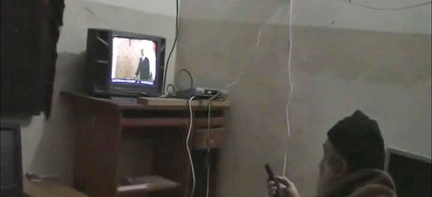 This undated image from video seized from the walled compound of al-Qaida leader Osama bin Laden in Abbottabad, Pakistan and released by the U.S. Department of Defense shows a man identified by the U.S. government as Osama Bin Laden in front of a TV.