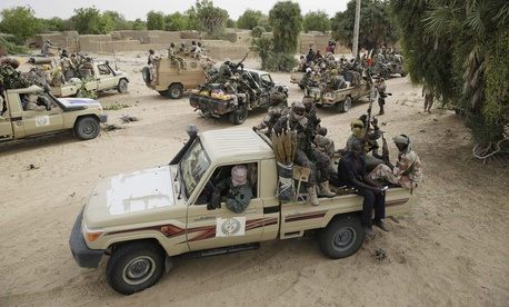 Chadian soldiers escorting a group of journalists ride on trucks and pickups in the city of Damasak, Nigeria, Wednesday March 18, 2015.