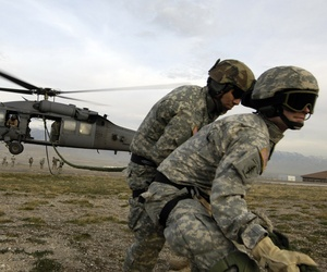 Soldiers from the 19th Special Forces retrieve a fast rope after being dropped from a Pave Hawk helicopter during a training exercise.