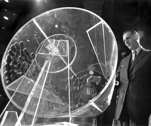 Draft Director Curtis W. Tarr is shown spinning a plexiglass drum at the beginning of the fourth annual Selective Service lottery in Washington in this Feb. 2, 1972 file photo.