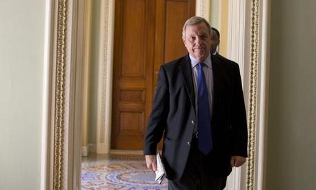 Senate Majority Whip Richard Durbin of Ill. walks to a Senate Democratic caucus, Monday, Sept. 30, 2013.