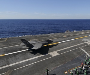 An F-35C Lightning II carrier variant Joint Strike Fighter conducts it's first arrested landing aboard the aircraft carrier USS Nimitz (CVN 68).