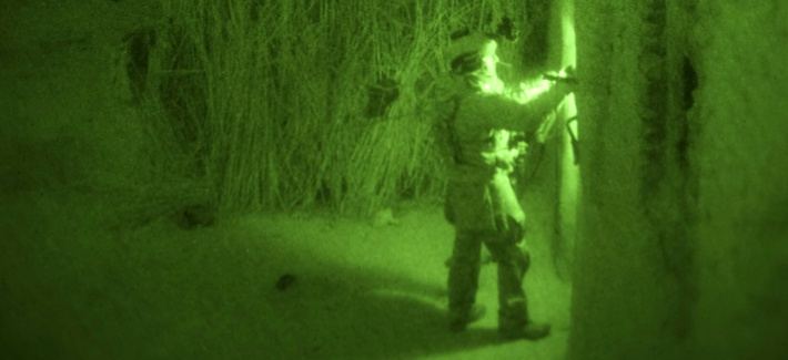A U.S. Army Green Beret checks an abandoned compound for explosives during a two-day operation Dec. 19 and 20, in Zhari District, Kandahar province, Afghanistan.