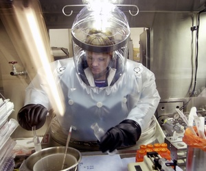 May 11, 2003, Microbiologist Ruth Bryan works with BG nerve agent simulant in Class III Glove Box in the Life Sciences Test Facility at Dugway Proving Ground, Utah.