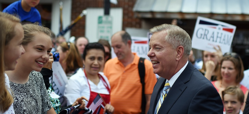 Sen. Lindsey Graham, R-S.C., greets supporters after announcing his bid for presidency, Monday, June 1, 2015.